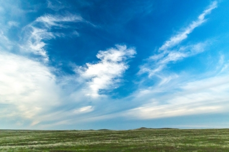 Grasslands and blue sky. Photo by Clayton Anderson.